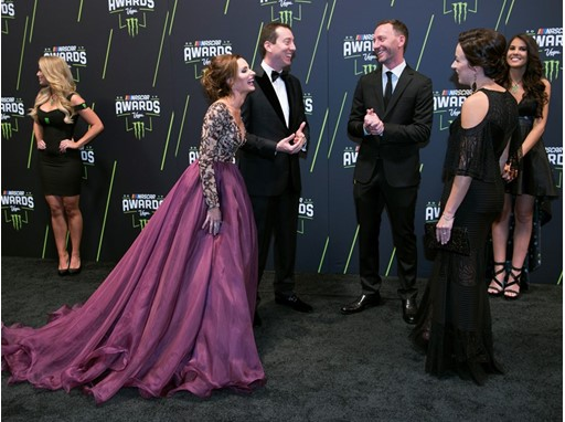 Kyle Busch and his wife Samantha Busch, left, talk with NASCAR crew chief Cole Pearn and his wife Carrie