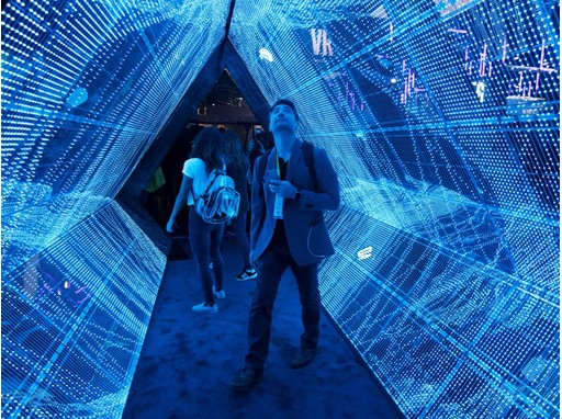 Todd Cox checks out a 5G tunnel from Intel during the second day of CES