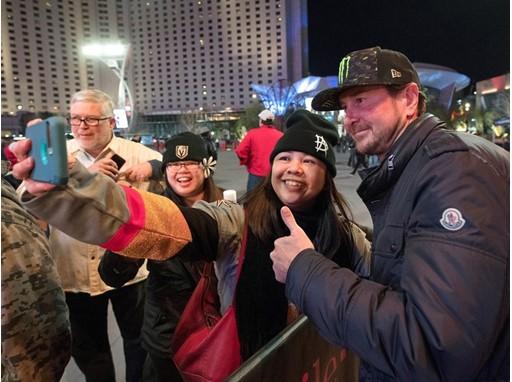 A fan takes a photo with Kurt Busch