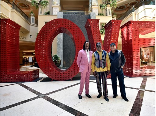 Verdine White, left, Philip Bailey and Ralph Johnson of Earth, Wind & Fire appear during a special arrival event