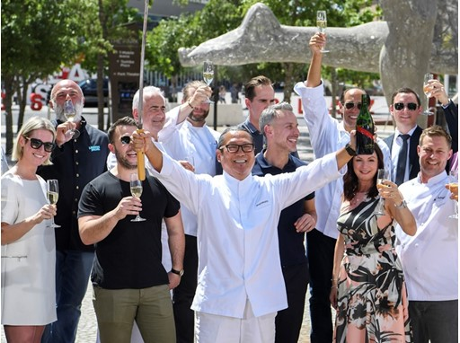 Chef Masaharu Morimoto uses his katana on a bottle of Prosecco as Vegas Uncork'd kicks off its 12th year