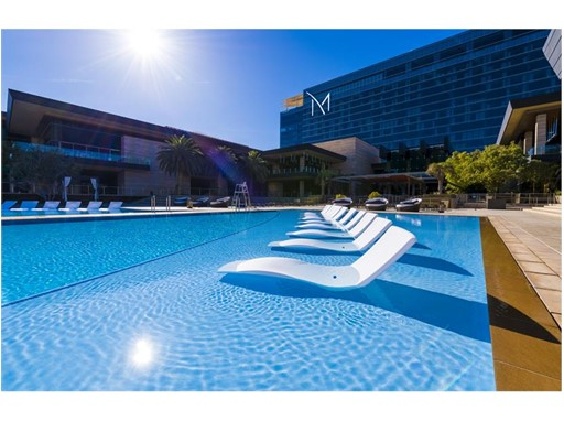 Partially submerged lounge chairs are perfect for cooling off in the sun at the M Resort