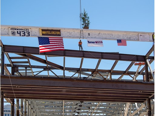 "The ""final"" signed beam is lifted into place"