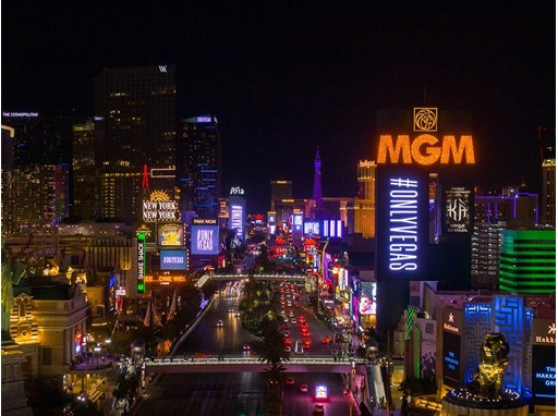 Strip view that feature #ONLYVEGAS on property marquees