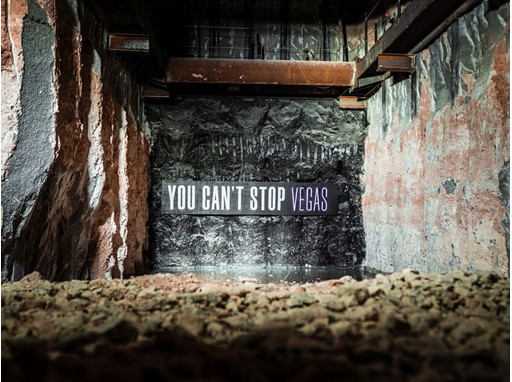 """You Can't Stop Vegas"" banner before Elon Musk's boring machine breaks through tunnel wall"