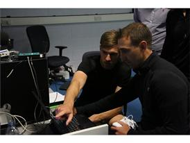 New Balance Football Athlete Aaron Ramsey Reviewing Data with Pedro Rodrigues from the New Balance Sports Research Lab