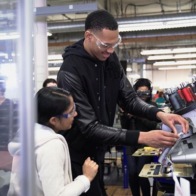 Darius on the footwear line at New Balance Factory