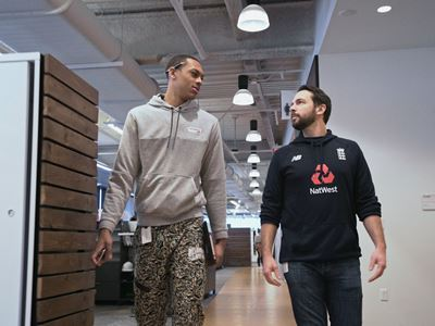 Darius and Pat Walking the Halls at New Balance HQ