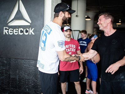 Reebok CrossFit trainer Conor Murphy shakes hands with Chris Irwin, Navy SEAL Foundation, at Reebok's Boston HQ.