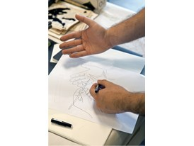 Mateo López draws in William Kentridge's Johannesburg studio.