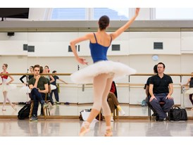 "While protégé Myles Thatcher (seated left) observes, mentor Alexei Ratmansky (right) directs a rehearsal of ""Paquita"" by"