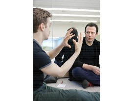Protégé Myles Thatcher (left) demonstrates a dance movement to mentor Alexei Ratmansky at the Chris Hellman Center for D