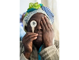 A Kenyan woman has her sight tested by Peek after an eye operation.