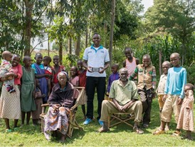Peek staffer Cosmas Bunywera (centre) with people whose sight he has tested using Peek devices.