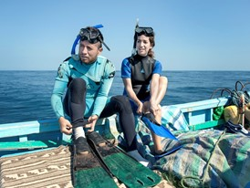 Laureate Kerstin Forsberg (right) and a colleague prepare to dive on a manta ray search.