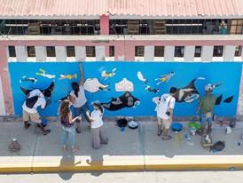 Community members in Zorritos, Peru, create a mural to raise awareness of manta ray protection.