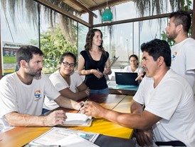 Laureate Kerstin Forsberg (centre) and her team in their office in Zorritos, Peru.