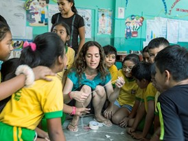 Laureate Kerstin Forsberg and school children play games raising awareness of manta ray protection.