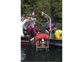 The remotely operated vehicle is placed in the water, ready for exploration.