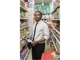 Young Laureate Oscar Ekponimo uses Chowberry on a tablet to register supermarket goods.