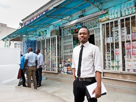 Young Laureate Oscar Ekponimo outside one of the retailers in Abuja, Nigeria, which uses Chowberry.