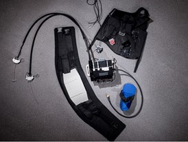 The components of an exosuit ready for assembly on a mannequin.