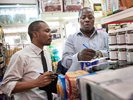 Supermarket manager Abduljeleel Salawudeen (right) and Oscar Ekponimo select items to list in the Chowberry app.