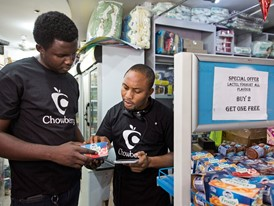 Chowberry colleagues using the application to record items in a supermarket.