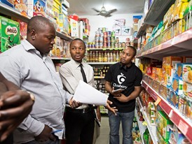 Oscar Ekponimo (centre) and supermarket manager Abduljeleel Salawudeen (left) select items for Chowberry.
