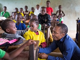 Oscar Ekponimo (right) visits Lea Wuye Primary, a Nigerian school whose pupils do not have enough to eat.