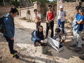 Christine Keung (centre) and colleagues test water from a well near Yanan, China.