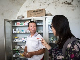 Christine Keung and village doctor Ma Juncheng in his clinic near Yanan, China.