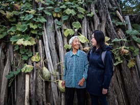 Christine Keung with 79 year-old Guo Aifang, one of many women participating in Keung's project.