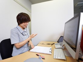 An interpreter at work using video chat at ShuR's office in Tokyo.