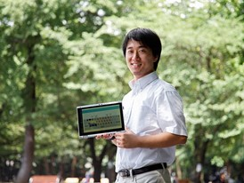 Young Laureate Junto Ohki displays signs on a computer tablet.