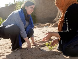 Sarah Toumi (left) planting seedlings.