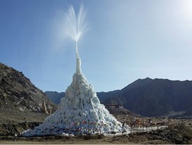 Gravity pressure forces water up through a pipe to form ice stupas that store water for the cropgrowing season