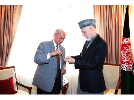 Rotary International President Kalyan Banerjee presented Afghan President Hamid Karzai with a special Rotary medal