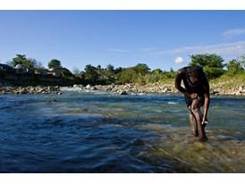 Catiana Doufi Bathes in the Rio Bajabonico