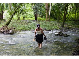 A Q'eqchi Maya Woman Gathers Water from the Tatin River Near her Home