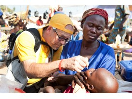 A Rotary club member administers a dose of polio vaccine to a child in Chad. Photo credit: Jean Marc Giboux