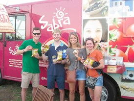 Fans enjoy free samples of Sabra hummus