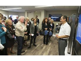 Proud Samsung employees and their parents learn about the latest advances in home appliances