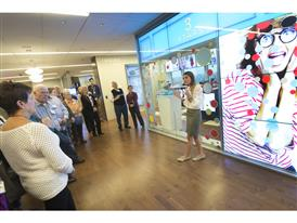 Proud Samsung employees and their parents learn about the latest advances in retail display technology