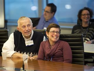 A Samsung employee and her father enjoy hearing from President and CEO of Samsung Electronics North America Gregory Lee
