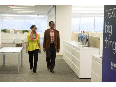 A proud Samsung employee shows their parent where they work during their Bring In Your Parents Day