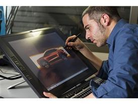 The designer Amin Sadek drawing the lines of 20V20 showcar in a virtual screen