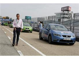 Javier del Hoyo heads to one of the SEAT cars he is going to drive with the help of an instructor