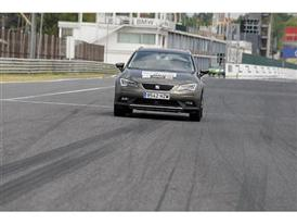 One of the participants driving a SEAT car on MadridGÇÖs Jarama track with the help of an instructor