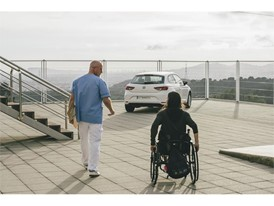 Patients use a real car to practice getting in and out of a vehicle